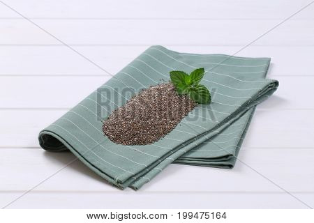 pile of chia seeds on grey place mat