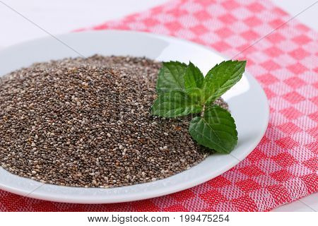 plate of chia seeds on checkered place mat - close up