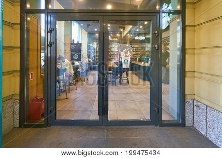 SAINT PETERSBURG, RUSSIA - CIRCA AUGUST, 2017: entry door at Starbucks coffee shop. Starbucks Corporation is an American coffee company and coffeehouse chain.