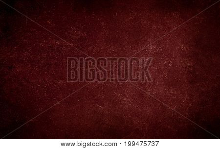 Red dark background of school blackboard colored texture or red paper texture. Red black vignetted blank aged background.