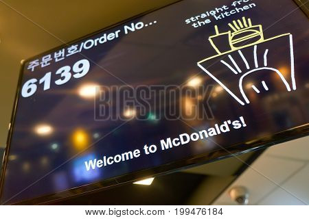 BUSAN, SOUTH KOREA - CIRCA MAY, 2017: close up shot of monitor at McDonald's restaurant. McDonald's is an American hamburger and fast food restaurant chain.