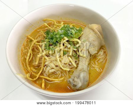 Thai Spicy Food, Egg Noodle In Chicken Curry In White Blow On White Background Or Name In Thai Is Kh