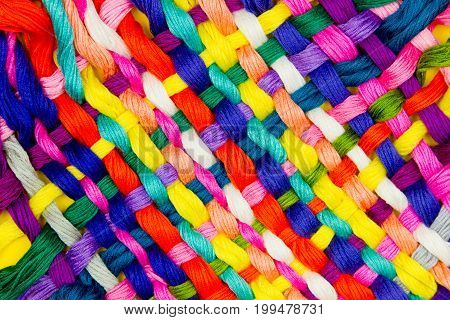 Pattern of colorful stripes of threads. Sewing / Embroidery background / texture