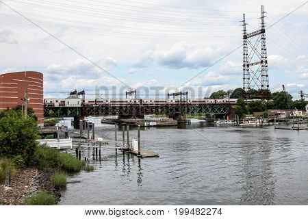 NORWALK - AUGUST 6: Railroad movable bridge near The Maritime Aquarium and IMAX Theatr building  as seen in Norwalk , CT on August 6, 2017.