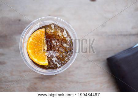 Ice americano top with piece of orange