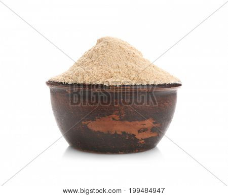 Bowl with rye flour on white background