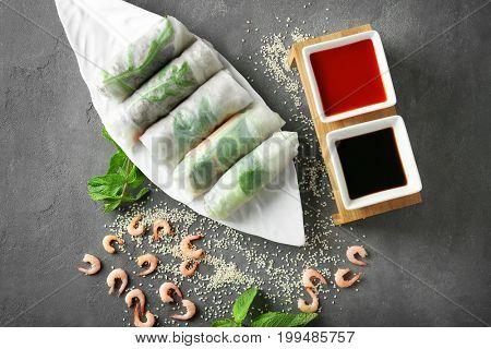 Portion of spring rolls on grey background