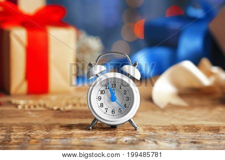 Retro alarm clock on wooden table. Christmas countdown concept