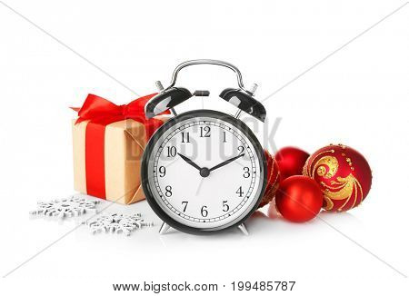 Retro alarm clock, decorations and gift box on white background. Christmas countdown concept