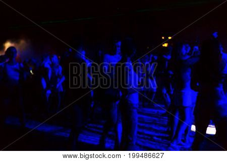 Creative Blurred Background Of The Spectators, The Fans On The Dance Floor Of A Night Club, Music Pa