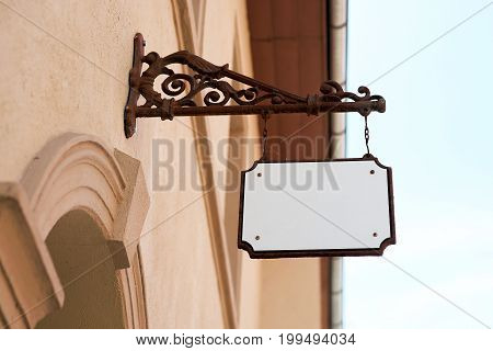 Empty signboard on the facade of a house