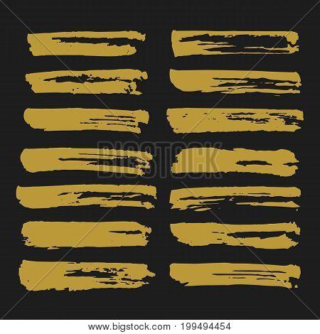Gold ink brush strokes set. Trendy hand drawn brush strokes. Vector brushstrokes isolated on black background