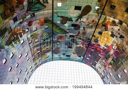 ROTTERDAM, THE NETHERLANDS - AUGUST 12, 2017: Colorful ceiling decoration of the new Market Hall located in the Blaak district Rotterdam The Netherlands