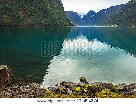 Oldenvatnet lake coast, Briksdal Glacier in Norway.