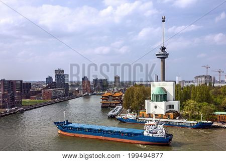Cargo vessel in port Rotterdam, The Netherlands.