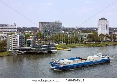 Rotterdam, Netherlands - Aug 15, 2017: Cargo vessel in port Rotterdam, Netherlands.