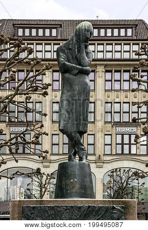 Hamburg, Germany - August 3, 2017: Monument to poet Heinrich Heine on Rathhaus square
