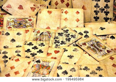 many old Poker cards close up photo