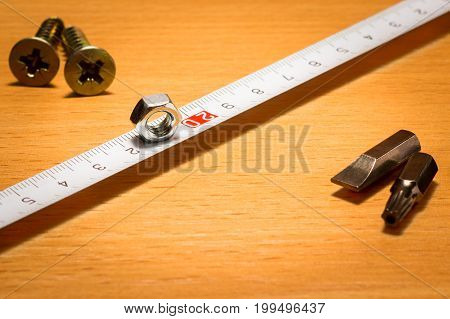 Tools for measuring and fastening a wooden background