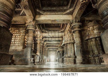 Columns and empty corridor inside the 12th century stone temple Hoysaleswara now Karnataka state of India.