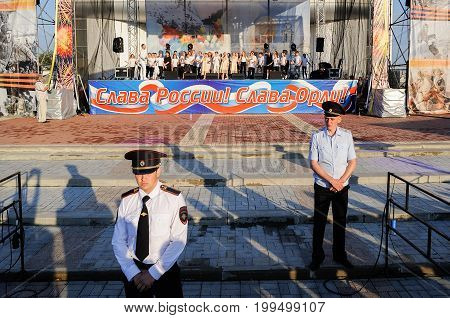 Orel Russia August 05 2017: City Day. Policemen guarding scene with choir horizontal