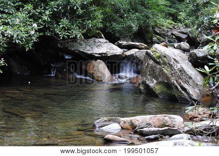 Water flows through the rocks as it heads down stream