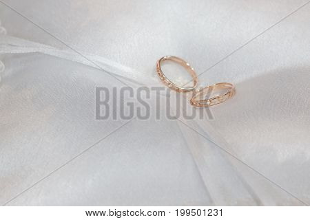 White cushion with wedding gold rings. Wedding day.
