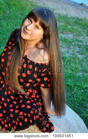 Beautiful young woman brunette with long hear, happy outdoor