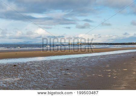 Ayr beach and harbour walls, Ayrshire, Scotland.