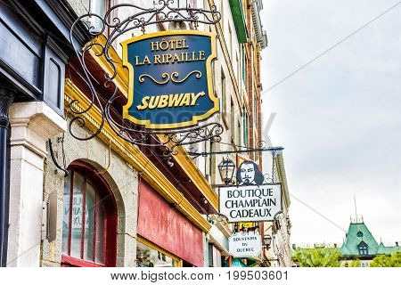 Quebec City Canada - May 29 2017: Old town street with Souvenirs sign at Boutique Champlain Cadeaux and Subway with Hotel La Ripaille