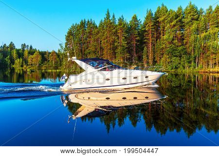 Scenic summer view of recreational yacht sailing by the lake water landscape among islands with deep forests in Finland