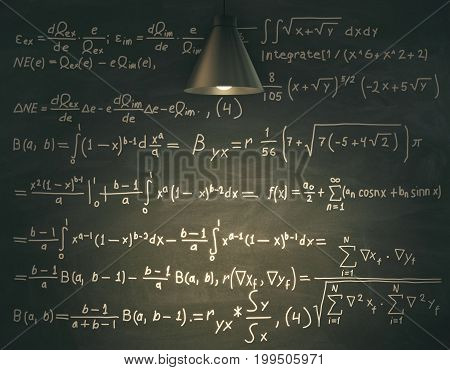 Blackboard with mathematical formulas illuminated with lamp. Education knowledge and science concept