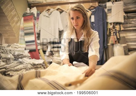 Dressmaker cutting a piece of fabric