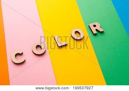 Word Color on bright colorful background. Rainbow spectrum, joy concept