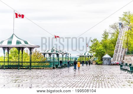 Quebec City Canada - May 30 2017: Old town view of Dufferin Terrace wooden boardwalk with benches gazebo and people walking