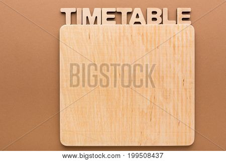Timetable with blank wooden board, copy space. Time management, work optimization supply