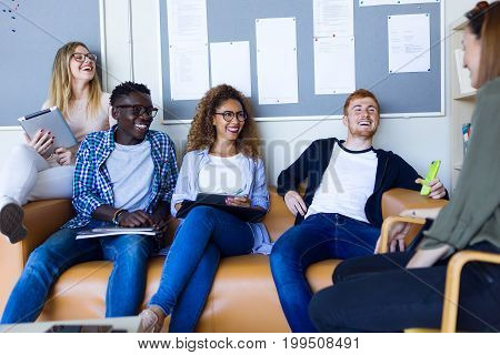 Group Of Happy Young Students Speaking In A University.