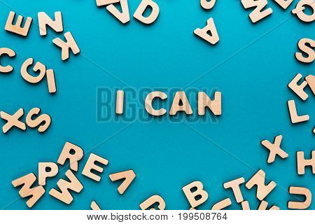 I can phrase in wooden letters frame on blue background. Success and challenge concept.