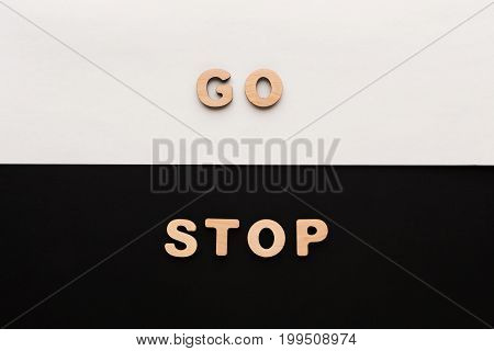 Words Go and Stop on contrast background. Start and finish, movement and standing concept