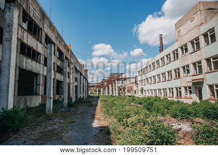 Abandoned city concept, abandoned buildings, perspective in sunny day