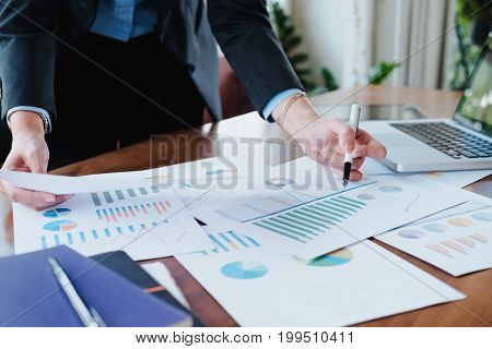 Working business people analyse high performance marketing data.
