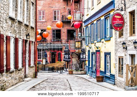 Quebec City Canada - May 30 2017: Lower old town cobblestone street called Sous le Fort with restaurants and Boutique La Chasse-galerie