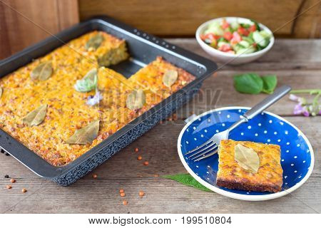 Homemade vegetable cake with red lentils and bay leaf.