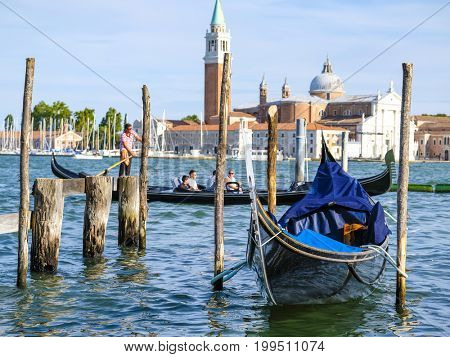 Venice, Italy, May, 31, 2017: gondolas on a channel in Venice, Italy