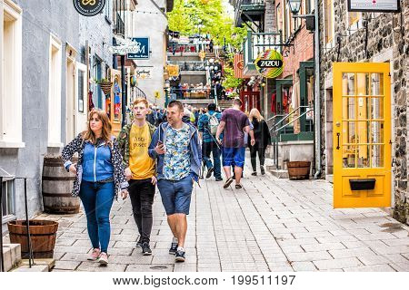 Quebec City Canada - May 30 2017: Lower old town street called Rue du Petit Champlain with tourist family people walking