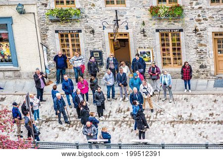 Quebec City Canada - May 30 2017: Aerial view of crowd group of tourists by lower old town stone buildings