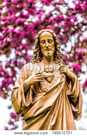Quebec City Canada - May 30 2017: Closeup of Seminary golden statue of Jesus Christ in garden