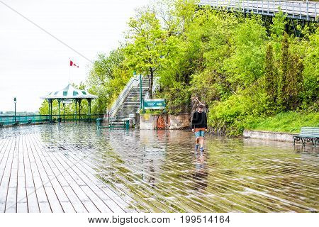 Quebec City, Canada - May 30, 2017: Old Town Street And View Of Dufferin Terrace In Heavy Rain With