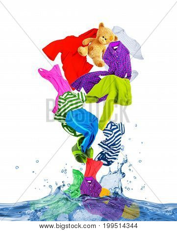 Colorful clothes fly out of the water on white background