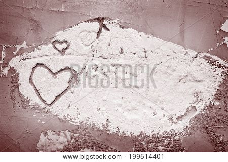 Aged cement gray wall texture with hearts